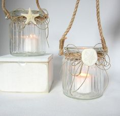 These containers look like they were recyled from larger candles.  Beach Decor Candle Votives - Seashell / Starfish Nautical Candle Jar Set of 2 w Nautical Roping