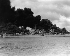 [Photo] Phoenix steaming past burning wrecks of battleships West Virginia and Arizona, Pearl Harbor, US Territory of Hawaii, 7 Dec 1941