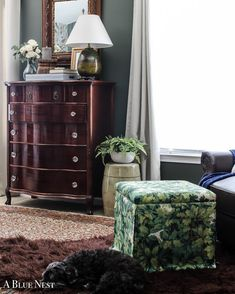 A modern country inspired living room where hardwood floors meet a cozy aesthetic of layered fabrics and secret storage in that ottoman to keep your space neat and organized. via @abluenest