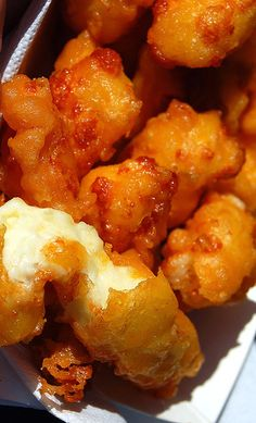 A Dairyland Delicacy, Deep Fried Cheese Curds. Need we say more! Un-aged WI cheddar cheese curds battered then deep fried for a warm buttery crunch. http://www.culvers.com/ http://bubbasfrozencustard.com/ http://oscarscustard.com/ http://www.foodspot.com/Clients/WI/Waukesha/MurfsFrozenCustardJumbo/default.aspx?accid=14340