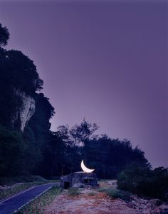 """""""Private Moon"""" by Leonid Tishkov (for ten years, the large illuminated moon has been placed in unexpected spots across the world)"""
