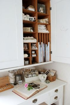 This is my style. Lovely things out where they can be seen. Also lovely things in the cabinet. The use of vintage accessories. Definitely my style.