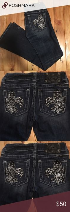 "Miss Me jeans Fleur de Lis Gorgeous Miss Me jeans size 25 boot cut jeans. Style JP5005-6ar Fleur de Lis. In great condition. No signs of wear or tear. Dark blue (stone wood) with slight fading & whiskering. Beautiful rhinestone Fleur de Lis designs on back pockets.  98% cotton, 2% elastin   Details: ⭐️I measured inseam at  30.5"" although tag says 31"" ⭐️13"" wide when laying flat  ⭐️7"" rise (higher on back) ⭐️boot opening 8.5"" Miss Me Jeans Boot Cut"