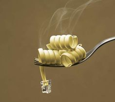 This is a really cool mix of technology and food. It definintly looks like a noodle and a wire and I like the smoke coming out of the top at first I thought it was just a noodle, and I think this is a really cool picture.