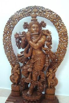 Krishna statue in teak wood with praba