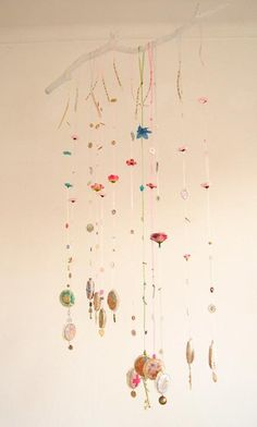 Old broken jewelry make lovely charms for a mobile- tree hangers?