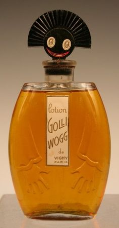 Le Golliwogg perfume bottle, de Vigny, Paris, 1920s. Black, animated head on the stopper with original paper label, Le Golliwogg was a rare French perfume that is no longer made. H: 6 5/8 (with stopper) x W: 3 1/4 x D: 1 1/4""