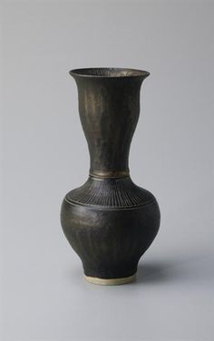 Byzantine-style vase, Porcelain, golden manganese glaze with sgraffito inside and out. 9 3/8 in. (23.8 cm.) high, c.1976