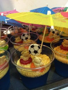 Jello cups for the kids. Blue jello, smashed shortbread cookies, life savers and teddy grahams. Little umbrellas from party city help to create the whole beach effect. I just added a soccer ball, even though it doesn't really match because it's for a soccer team.