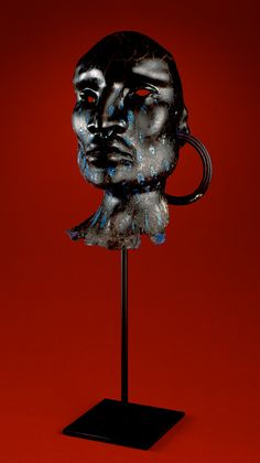 "Artist Selections - William Morris | Glass Artist//Nuba Man, 2001 blown glass with steel stand  23""h x 10""w x 8""d"