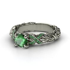 This would be nice with sapphire and emerald Round Emerald 14K White Gold Ring with Emerald | Knotted Bouquet Ring | Gemvara