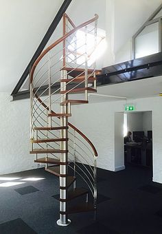 Apollo Spiral Staircase with Stainless Steel balustrade, used to access a mezzanine in an office. http://www.spiralstairs-direct.co.uk/shop/product.php/105/apollo-spiral-staircase-with-stainless-steel-balustrade