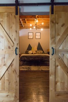 The barn doors to the bedroom are from Home Depot, but Darcy and Mike stained and installed the doors themselves.