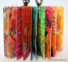 Mini art journal - half full! by thekathrynwheel, via Flickr -- so many lovely pages!