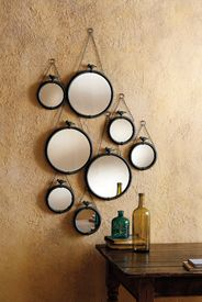 I love the effect of so many of these mirrors grouped together but they're pretty pricey. #mirror #rustic #decor #hanging