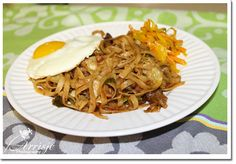 Bahmi Goreng is the noodle equivalent of nasi goreng, or Indonesian fried rice. Like fried rice, it can accommodate whatever leftovers you have in the cupboard. So use this recipe as a guide. Dutch like to serve it with extra kejap manis and sambal on the side.