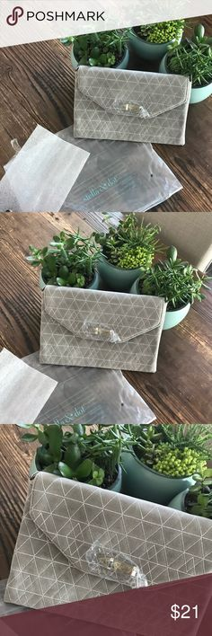 Stella & Dot Grey Fabric Clutch Brand New.   Bundle two items or more & get an auto 15% discount. Offers are welcome & always responded to with acceptance or counter.   All items come from a well kept, smoke free, pet free home. I only list items that are NWT, NWOT or VERY gently worn, all other items from my closet clean outs are donated. Thanks for looking! Stella & Dot Bags Clutches & Wristlets