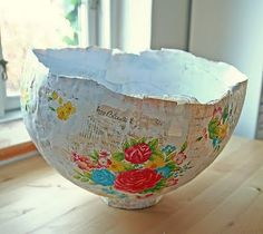 papier maché bowl. I imagine all this takes is a strong balloon, some modpodge, and some great washi or japanese tissue.