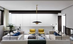 {Echlin London renovated three adjacent properties to create Kenure House. Clever openings in the plans keep things airy and breathable. Inside, a palette of marble, stone, linens, leather and timber create a tactile and warm interior environment.}...