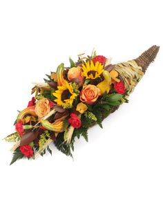 A gorgeous Table Centerpiece for your Fall festivals made with a natural cornucopia basket, and including sunflowers, roses, carnations, accent flowers, cattails, natural wheat, and greens. A made to order fresh centerpiece for your Thanksgiving dinners.