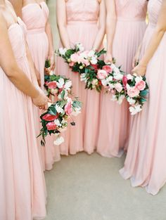 pink maids in strapless maxi dresses