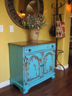 faux finished shabby chic turquoise cabinet - would love to do this to kitchen cabinets!