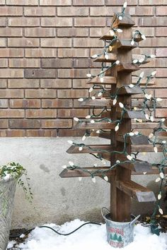 Use up scraps of 2x4s to make these fun wood Christmas trees. They are easy to make and add extra Christmas cheer to your front porch. Housefulofhandmade.com #ChristmasTree #DIY #WoodenChristmasTree