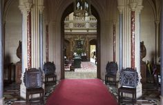 Highclere Castle entrance hall, which leads through to the saloon, is decorated with a Gothic fan-vaulted ceiling and a geometric parquet floor.