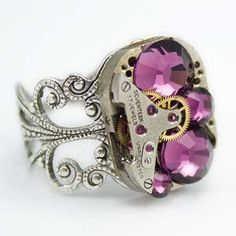 Steampunk Ring is made from a Vintage Ruby Jeweled Watch Movement and is set with Bright and Shiny Purple Amethyst Swarovski Crystals.