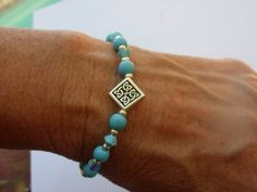 Celtic diamond shape silver station with silver & turquoise beads. Turquoise is said to protect against falls, dispels negativity, and warns of infidelity. A symbol of youth, vitality and love that bestows a sense of well being to the wearer.