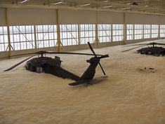 Eight helicopters covered with 7 feet of  fire suppression foam at the Army Aviation Support Facility (AASF #2) at the St. Cloud airport. Barely visible  below the foam are UH-60 Black Hawk helicopters most probably belonging to the local based C Company, 2nd General Support Aviation Battalion, 211th Aviation Regiment (Air Ambulance), a Minnesota Army National Guard aeromedical evacuation company.