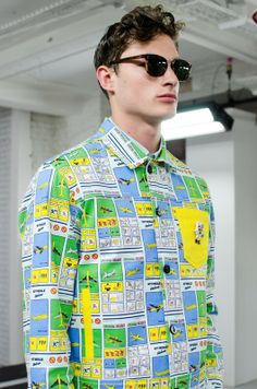 From airplane safety cards to ice-cold Coca Cola, Kit Neale goes on vaycay for SS15, London Collections: Men. More images here: http://www.dazeddigital.com/fashion/article/20327/1/kit-neale-ss15