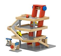 {Parking Garage} Crank the elevator to raise the two wooden cars up all four levels, then watch them roll down the ramps.