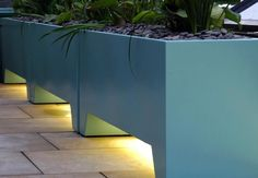 Pottery planter boxes, fabulous color and modern line. Lovely.