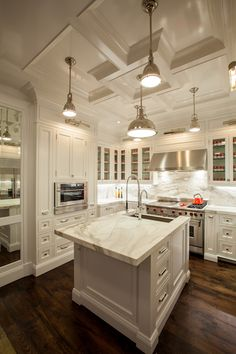 The Renovated Home - white kitchen cabinets, white marble countertops, marble backsplash, white mar...