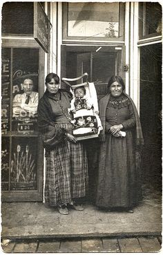 Indian Women and Child in Front of Store, c. 1910. Real Photo Post Card