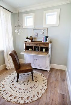 Office painted in Silver Strand SW 7057 Sherwin Williams with crochet rug and vintage desk.