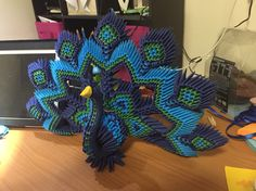 3D origami peacock - tutorial by Girnelis on YouTube- Hours of work folding over 1000 individual pieces finally comes together