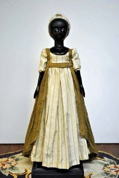 Hand carved wooden doll. This doll is such a beautiful doll, her dress is just so lovely.