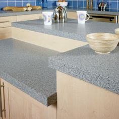First of all, the laminate worktops are cheap and therefore they do look inexpensive. Laminate Kitchen Worktops, Coffee Vending Machines, Cheap Kitchen, Work Tops, Table, Dream Homes, Furniture, Home Decor, Decoration Home