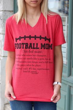 "Football Mom definition v-neck tee. Short sleeve, fitted women's fit tee. Super soft.  ""1. A mother who raises her champion. 2. Whose car smells like a gym, has an empty refrigerator, sore lungs, and a full heart. 3. One who prays when he plays. Synonyms: son's #1 fan, superwoman, loud & proud."""