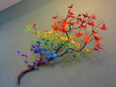 Teach a whole class to make origami cranes for a teacher gift. There are tons of origami instruction videos online. Alternatively, you can also use origami flowers or string the cranes up in a mobile. I love the ROYGBIV pattern here.