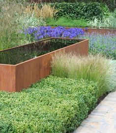 RHS Hampton Court Flower Show Vestra Wealth's Gray's Garden By garden designer Paul Martin. Paul Martin has taken inspiration for Vestra Wealth's Gray's Garden from the Irish designer, Eileen Gray, famous for her Modernist furniture and architecture.