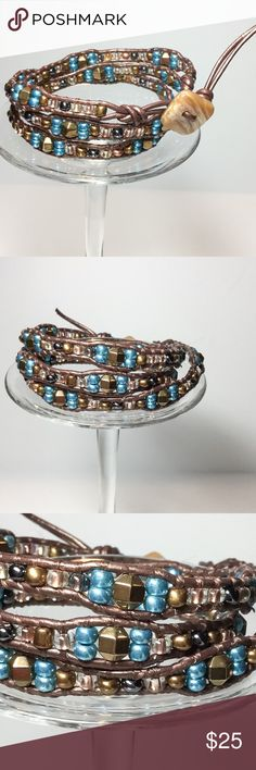 "Handmade 3 Wrap Bracelet The perfect every-day bracelet for your casual lifestyle. Looks great alone, but is also a wonderful piece for layering and stacking with other bracelets to create your own unique look. Hematite copper mix Czech Glass seed breeds and copper tone metal beads are woven onto Tamba leather cord and accented with a button clasp. Wraps around your wrist 3 times. Finished Size 22 3/4 "" long. Handmade Jewelry Bracelets"