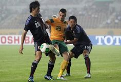 HWASEONG, SOUTH KOREA - JULY 25: Tomi Juric of Australia compete for the ball with Yuzo Kurihara and Hideto Takahashi of Japan during the EAFF East Asian Cup match between Japan and Australia at Hwaseong Stadium on July 25, 2013 in Hwaseong, South Korea.  www3.daylife.com/photo/02zt34wa4S80p