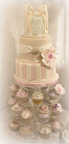 Whimsical Wedding Cake - Soft pastel hued cake with matching cupcakes