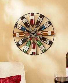 """This Metal Wine or Beer Bottle Clock makes a statement on any wall of your home. Perfect for enthusiasts, each hour is marked with a bottle. Requires 1 """"AA"""" bat"""