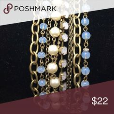 Stunning 10 Strand Vintage Gold Tone Bracelet Stunning 10 Strand Vintage Gold Tone Bracelet. strands are faux pearls, rhinestones, opalite stones, with rondells, chains, prong set opalite cabs, and Crystals. has a magnetic clasp that snaps close. Definitely a statement  Bracelet. Very Beautiful and in Great Condition. Jewelry Bracelets