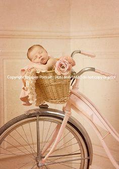 newborn baby in a bike basket- inspire portrait