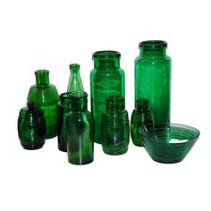 Collection of Green Glass Vessels  France  early 20th century  Collection of 12 pieces of deep green glass from France, early 20th century; various patterns/forms.
